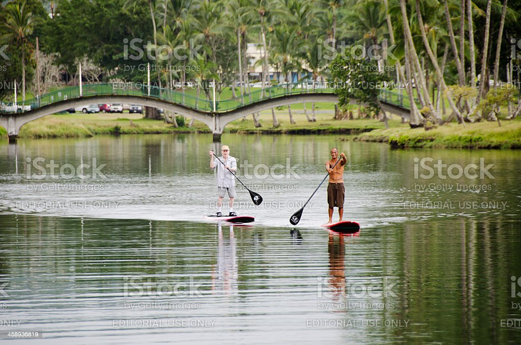 Paddle Boarders in Hilo stock photo