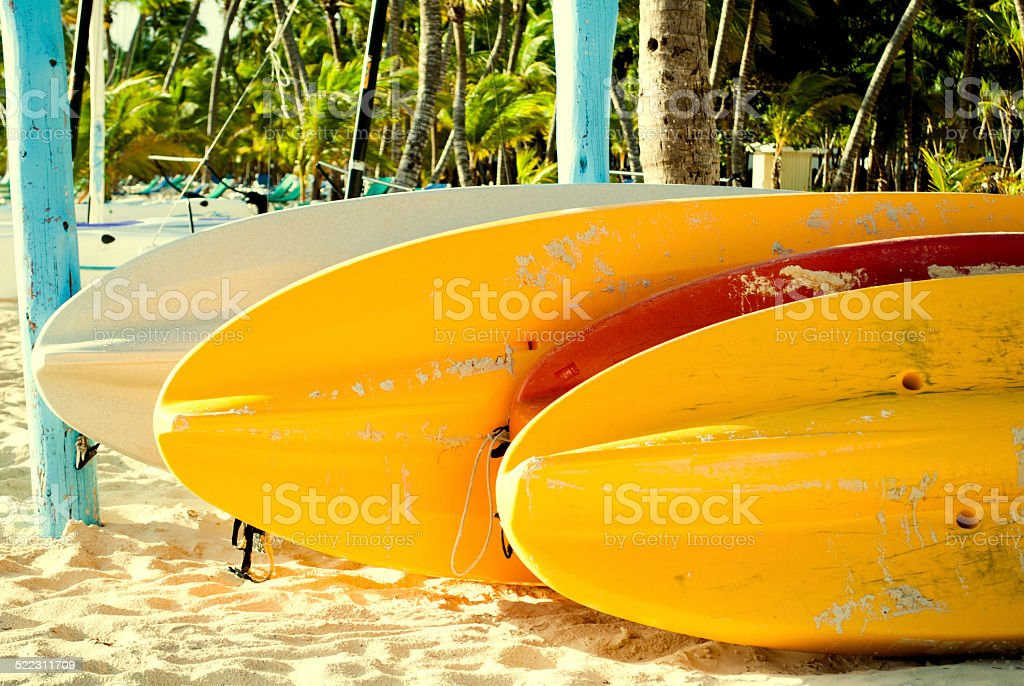 Paddle boards on beach stock photo