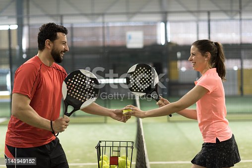 istock paddle tennis couple players ready for  class 1141949152