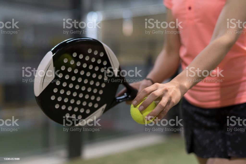 Paddle tennis player racket and ball ready for serve close up anonymous image stock photo