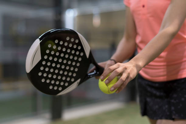 paddle tennis player racket and ball ready for serve close up anonymous image - table tennis racket stock pictures, royalty-free photos & images