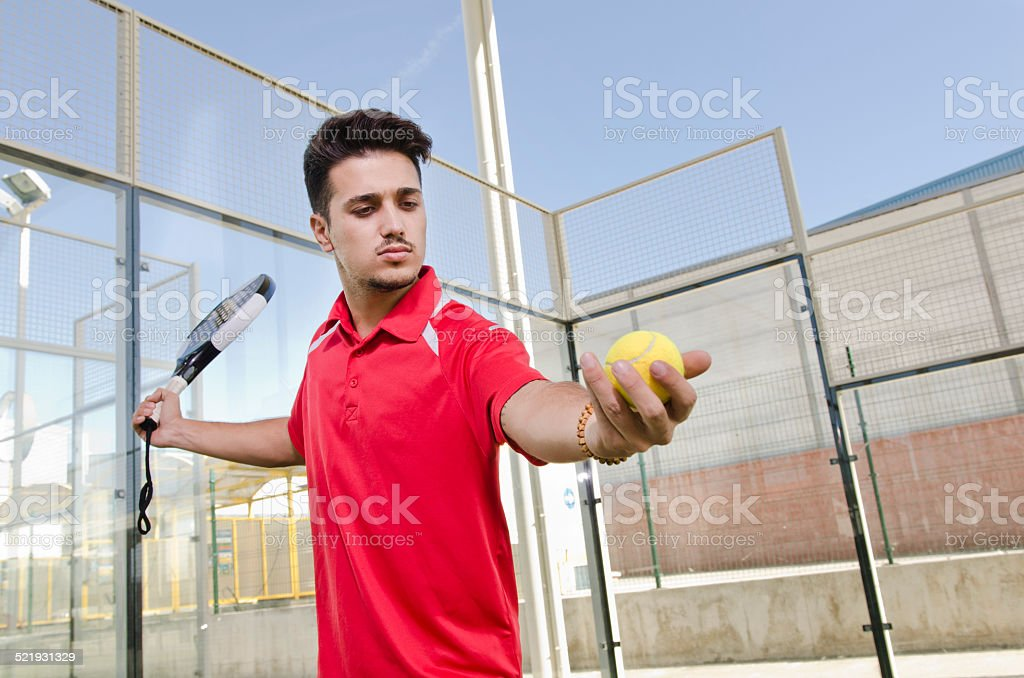Paddle tennis player ready for serve ball stock photo