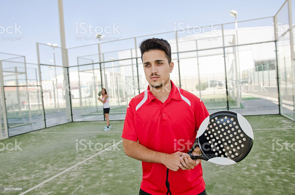 Paddle tennis player ready for serve stock photo