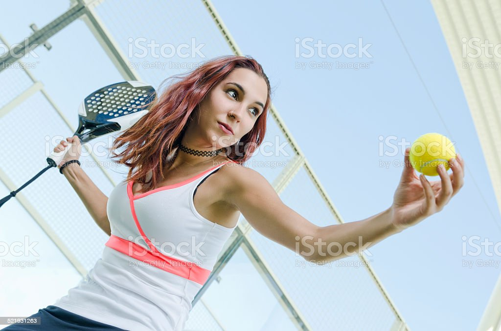 Paddle tennis woman player ready for serve ball stock photo