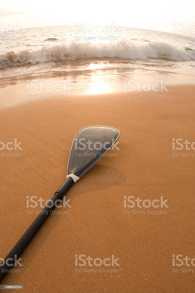 Paddle Waiting on the Beach stock photo