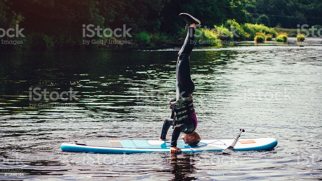 Paddleboard Headstand stock photo