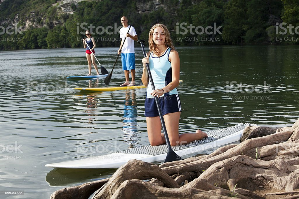 paddleboarding female stand up paddling royalty-free stock photo