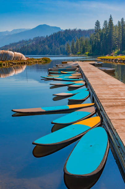 Paddleboards at dock in Hume Lake near Kings Canyon National Park, CA stock photo