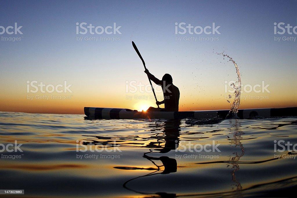 Paddler at Sunrise royalty-free stock photo