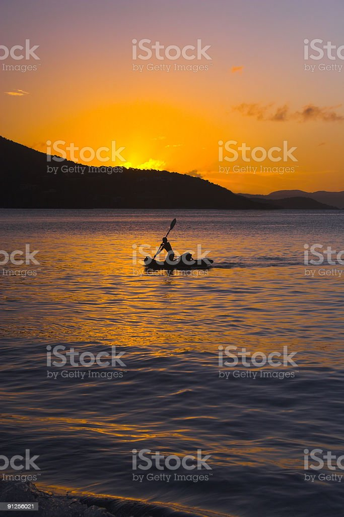 Paddler in Sunset royalty-free stock photo