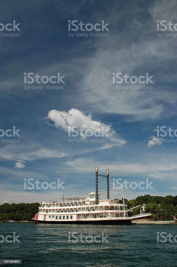 Paddlewheel crossing the lake in cloudy weather stock photo