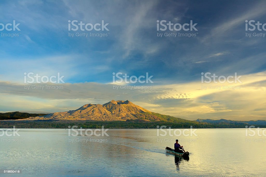 Paddling A Canoe in the Sunrise stock photo