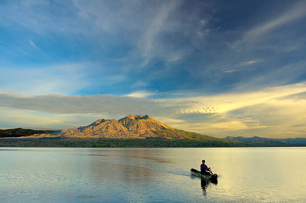 Paddling A Canoe in the Sunrise stock photo