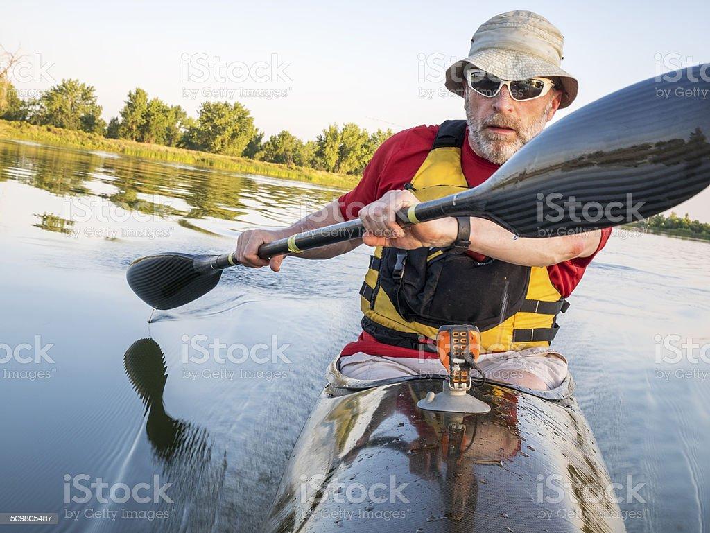 paddling a  fast kayak stock photo