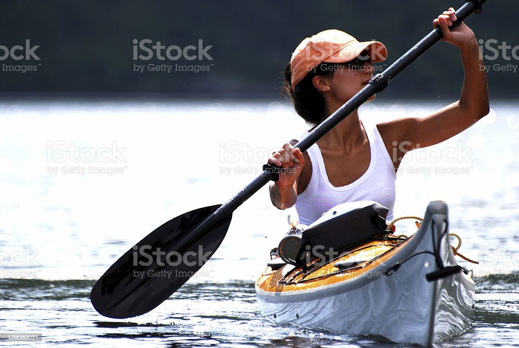 Paddling Calm Waters royalty-free stock photo
