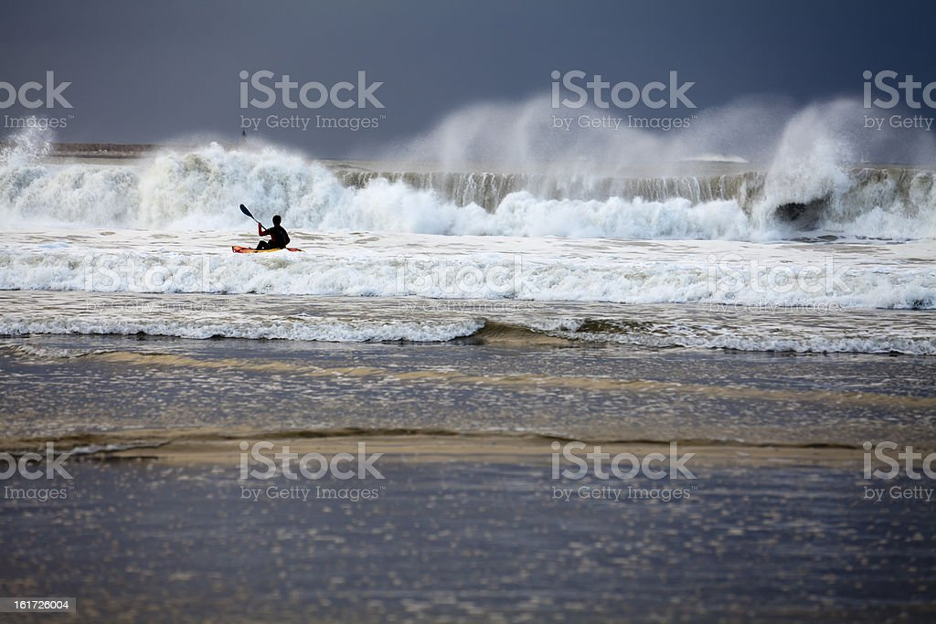 Paddling huge waves royalty-free stock photo