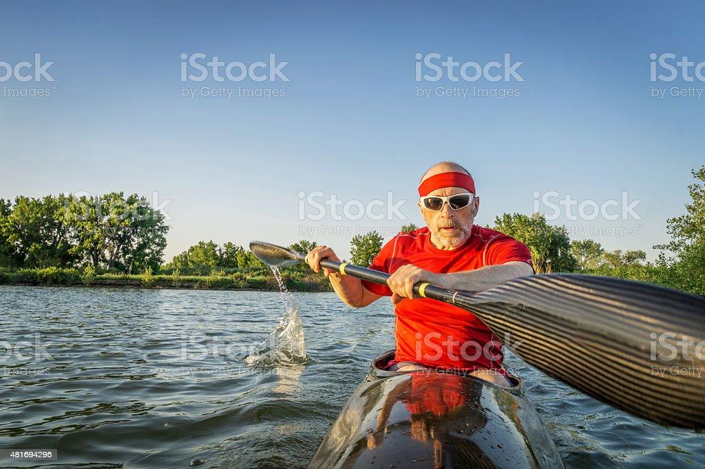 paddling racing sea kayak stock photo