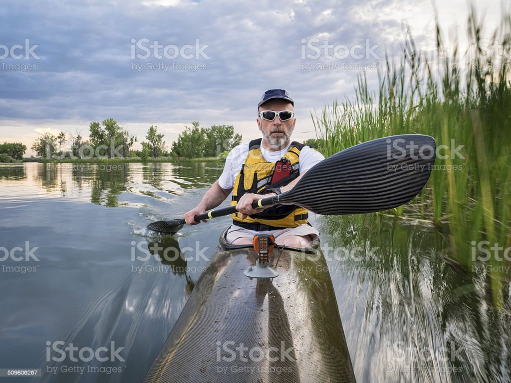 paddling sea kayak on a lake stock photo