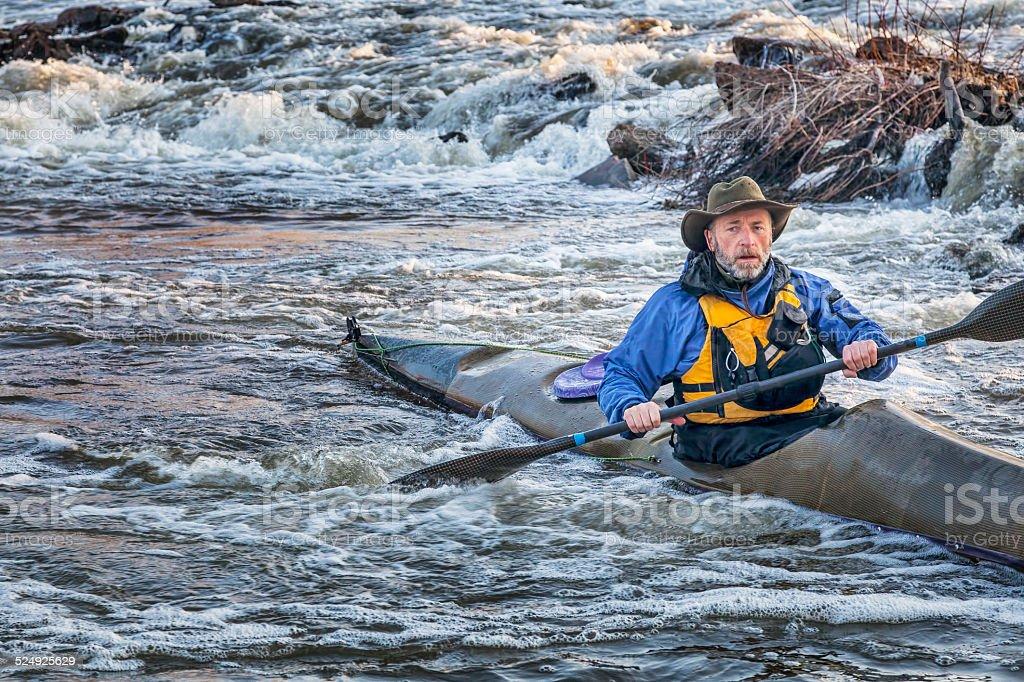 paddling sea kayak on a river stock photo