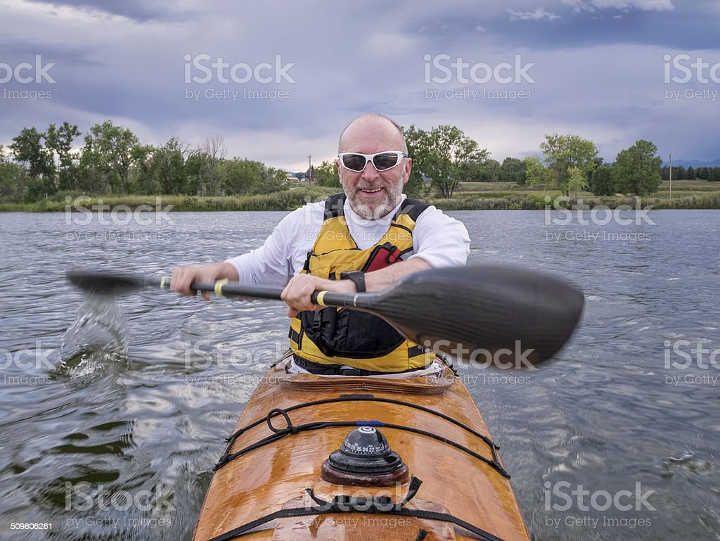 paddling sea kayak stock photo