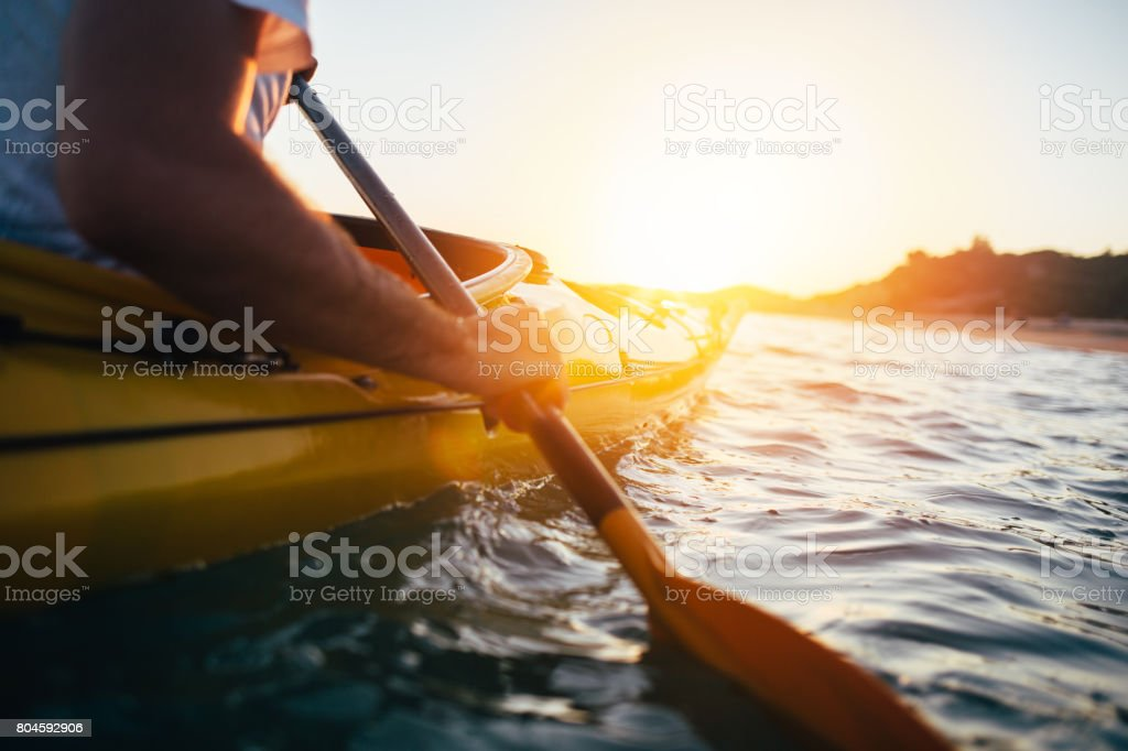 Paddling the kayak stock photo