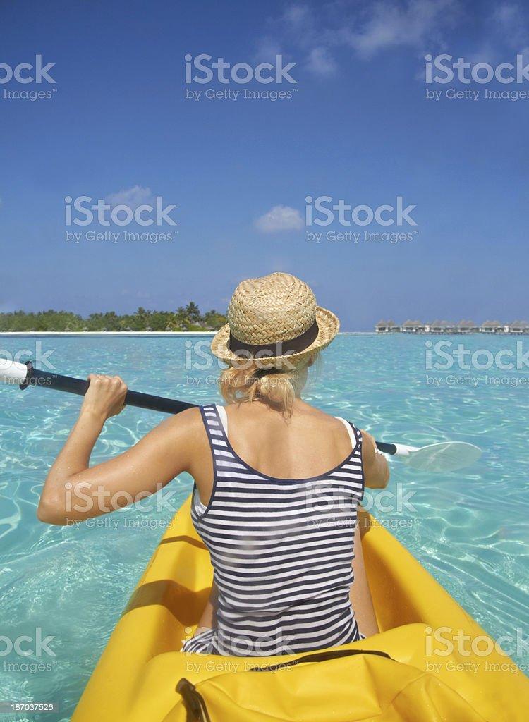 Paddling to paradise royalty-free stock photo