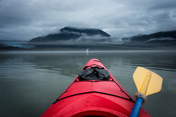 paddling toward mendenhall glacier and waterfall - kajak paddel stock-fotos und bilder