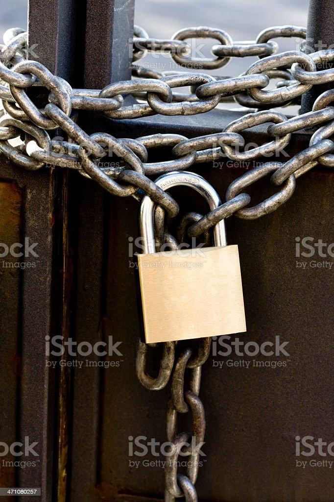 Padlock and chain closing gate. Series royalty-free stock photo