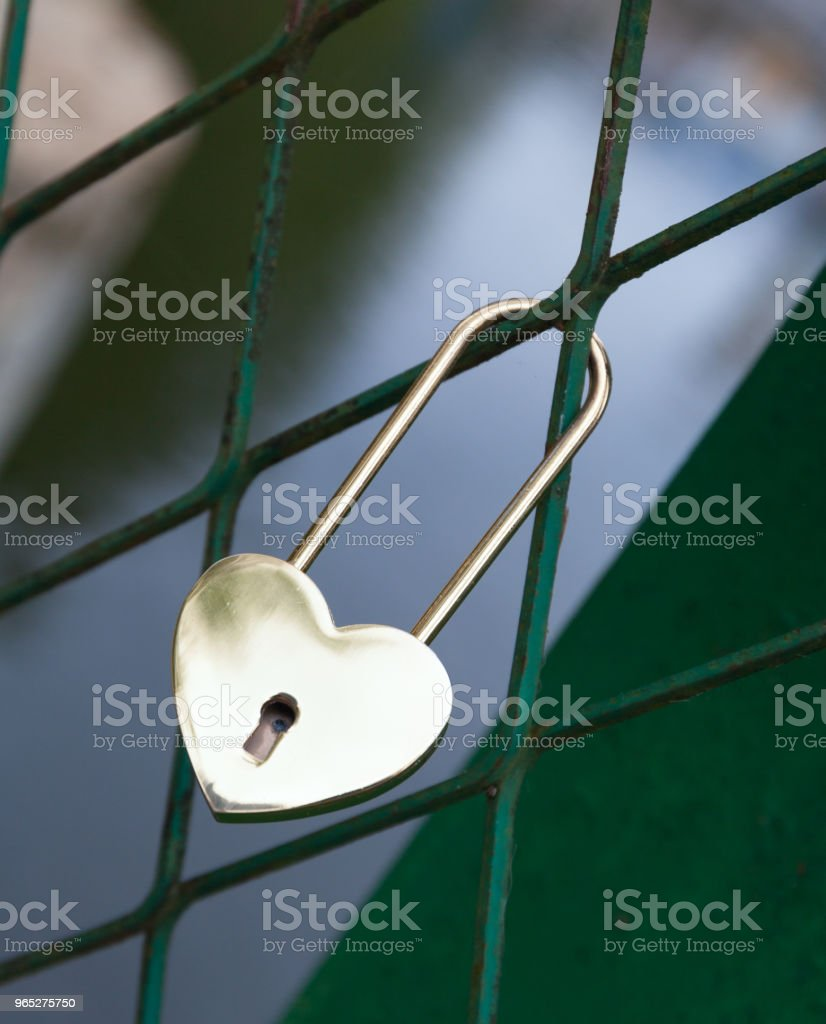 Padlock in the form of gold heart. symbol of the wedding and the unity of the couple. Royal royalty-free stock photo