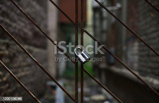 bad neighborhood behind closed metal lattice fence