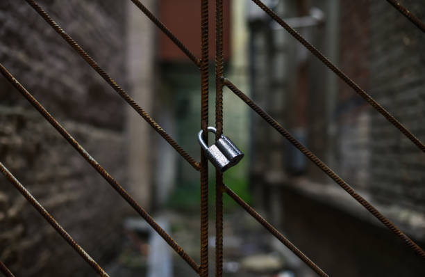 padlock metal lattice fence stock photo