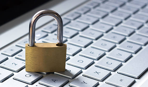 padlock on a laptop keyboard. - www xx stock photos and pictures