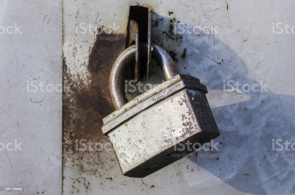 Padlock on an old metal door royalty-free stock photo