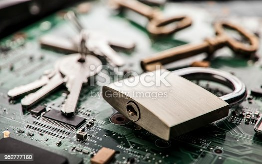 istock Padlock on computer circuit board.Security concept 952777160
