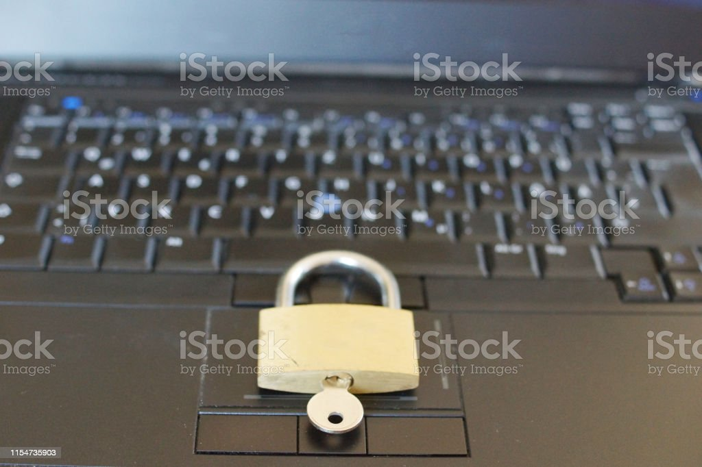 Silver Padlock on computer keyboard. Network Security, data security...