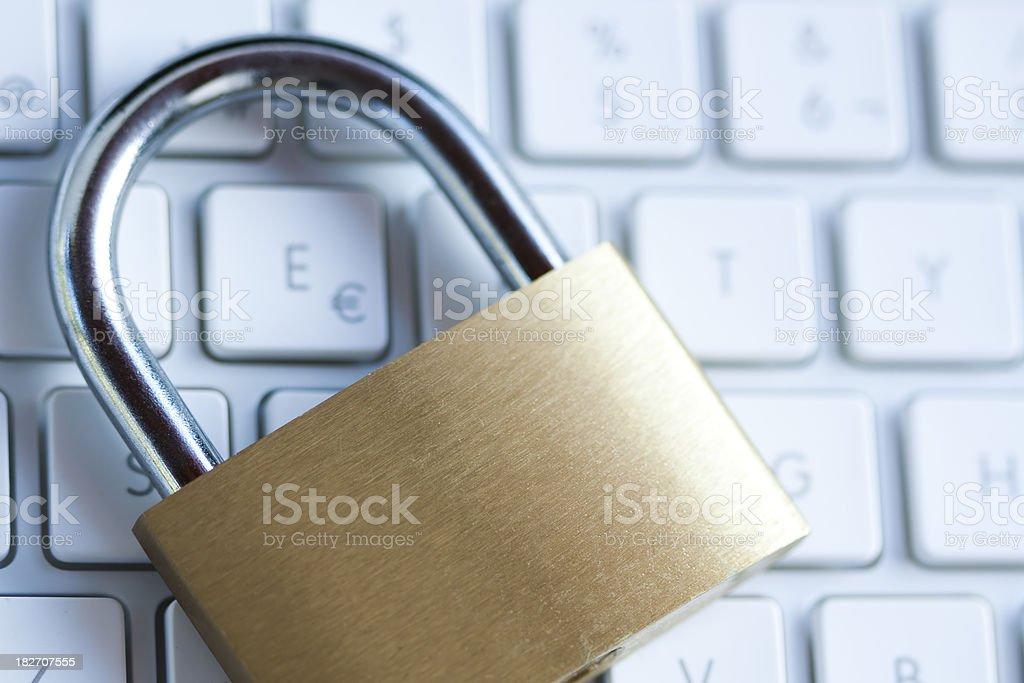 Padlock on computer keyboard royalty-free stock photo