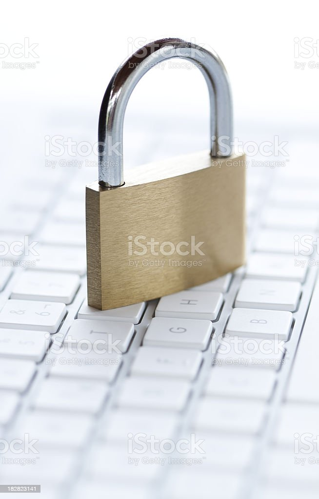 Padlock on computer keyboard royalty-free stock photo