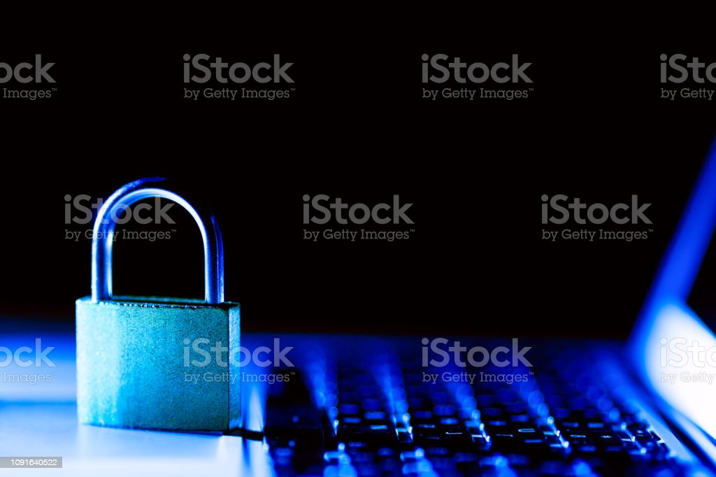 Padlock on laptop. Internet data privacy information security...