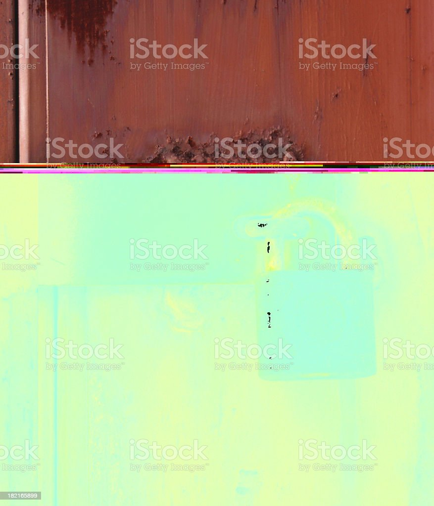 padlock on rusty door royalty-free stock photo