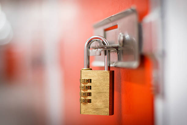 Padlock Gold padlock with code to secure storage padlock stock pictures, royalty-free photos & images
