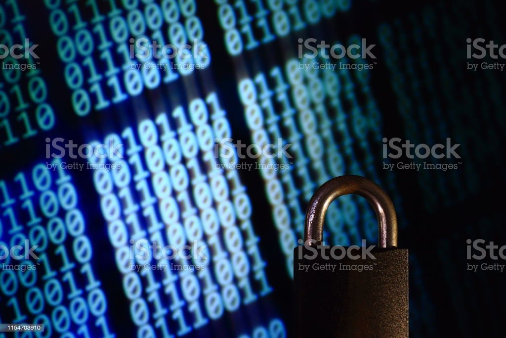 binary computer language matrix blurred be hide an iron Padlock. sign...