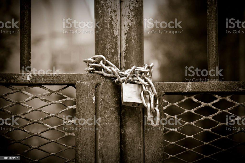 Padlock with rusty chain stock photo
