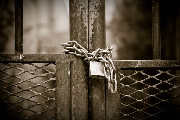 Padlock with rusty chain stock photo