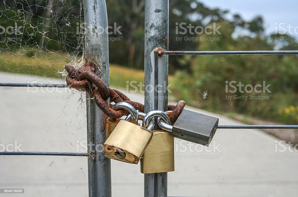 Padlocked metal gate in the country stock photo