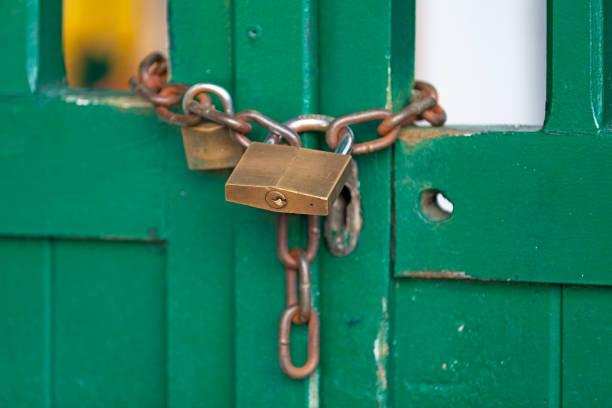 Padlocked wooden door stock photo