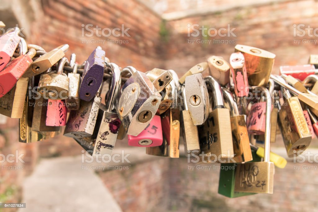 Padlocks left by lovers as a promise of love. stock photo
