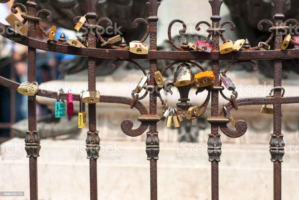 Padlocks on the fence of Pontevecchio bridge in Florence, Italy stock photo
