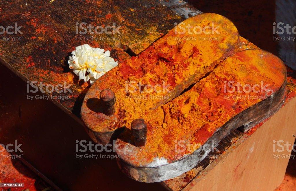 Padukas wooden footwear of Hindu God lord Shiva idol in temple stock photo
