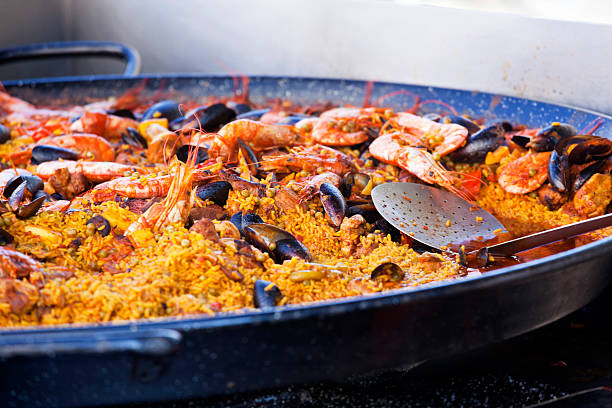 paella at the food market - paella stock photos and pictures