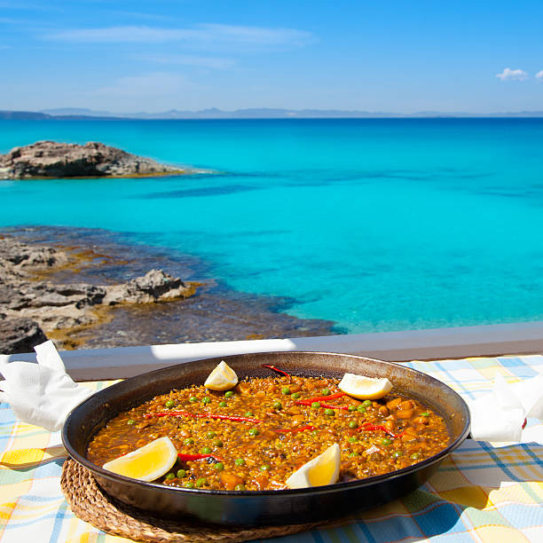 paella mediterranean rice food in balearic islands - paella stock photos and pictures